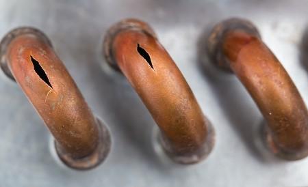three plumbing pipe leak pinholes