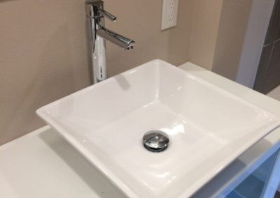 New square white sink with sleek faucet