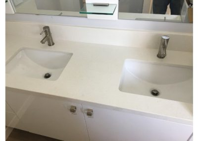 New dual white bathroom sinks installed