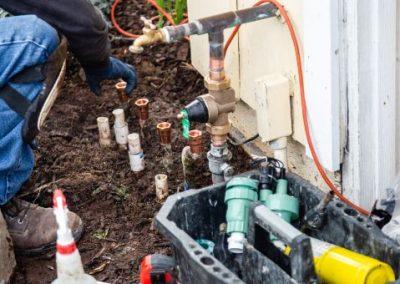 sprinkler re-pipe - plumber at work