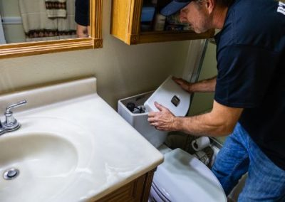 toilet repair by RT Olson Plumbing