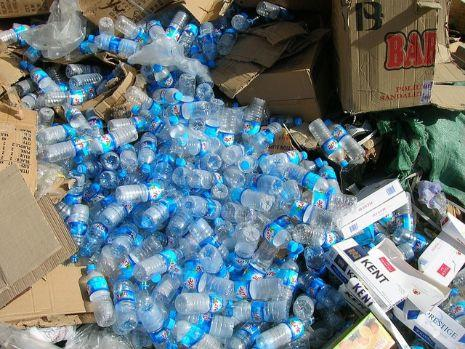 garbage pile of plastic water bottles