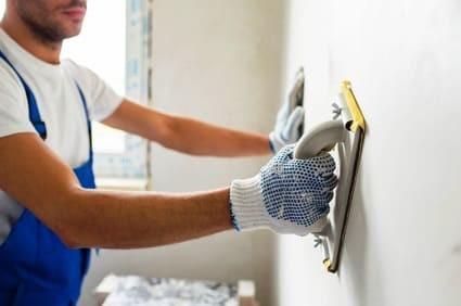 plasterer repairing drywall