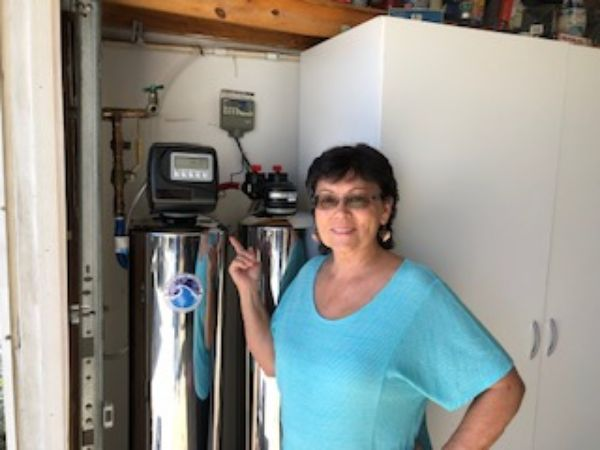 happy customer with new whole house water filtration and softener