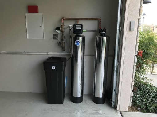 water softener and whole house filtration system installed in garage
